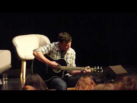 Travis Wester singing and playing guitar at the fhth con