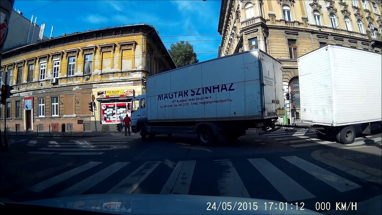 Truck driver skills: turning two tight corners downtown Budapest.