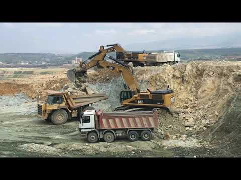 Caterpillar 385C Excavators Loading Dumpers And Trucks - Labrianidis SA
