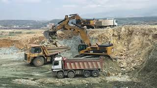 Caterpillar 385C Excavators Loading Dumpers And Trucks - Labrianidis SA