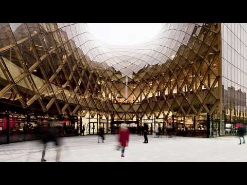 """Shopping centre's swooping entrances """"drag people inside"""" says architect"""