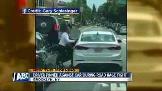 Driver pinned against car in road rage incident
