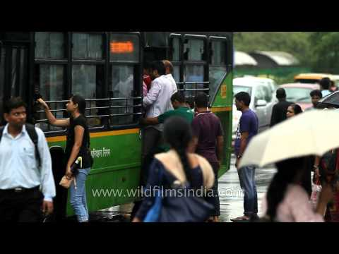 Delhi citizens flock to buses on a suddenly rainy afternoon