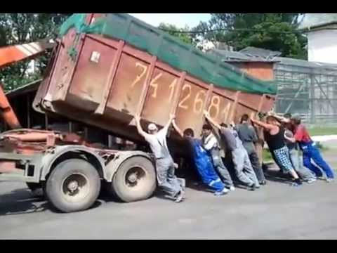 Hook Lift Truck loading up a container [Funny Video]