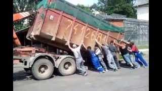 hook lift truck loading up a container funny video