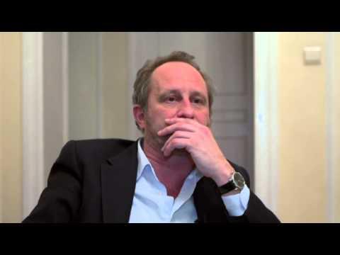 Benoît POELVOORDE parle à sa manière des villes de Belgique