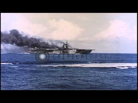 United States ship bombards Mt. Suribachi as an aircraft is shot down in Iwo Jima...HD Stock Footage