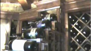 Glass Enclosed Wine Cellar With Wood & Metal Wine Racks