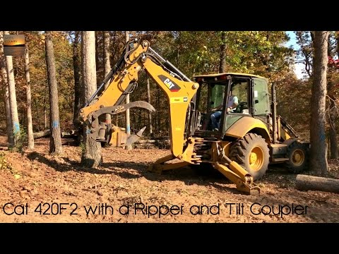 Cat 420F2 Clearing Trees with a Ripper Tooth and PSM Tilt Coupler