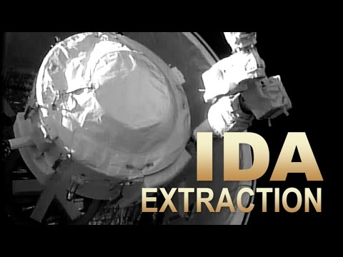 International Docking Adapter Is Extracted From SpaceX Dragon
