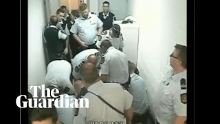 Footage shows Indigenous prisoner being restrained before death