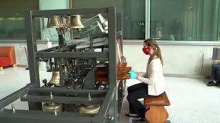 student playing bells on portable campanile model