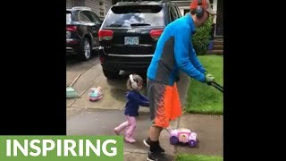 Father & daughter take lawn mowing very seriously!