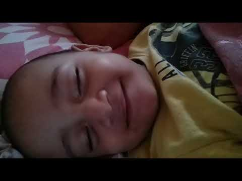 Cute Baby Smiling While Sleeping
