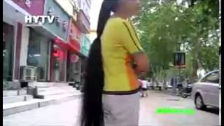 Girl from Henan has almost floor length long hair