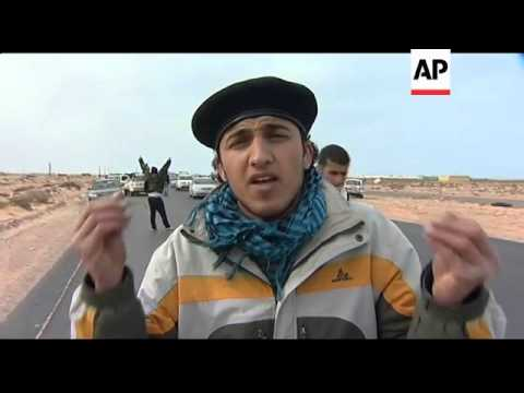 Gadhafi forces drive hundreds of rebels from strategic oil port