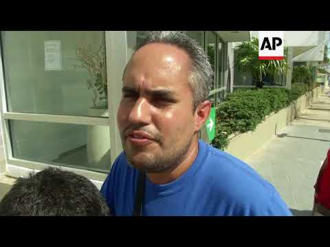 Puerto Ricans stand in line for cash at banks