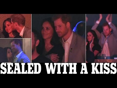 Sealed with a kiss! Meghan Markle and Prince Harry at Invictus Games closing ceremony