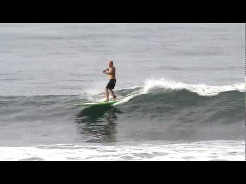 paddleboarding on the Michael Dolsey TUNA SUP in  Playa Hermosa Costa Rica