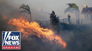 Wind-driven wildfire explodes north of Los Angeles