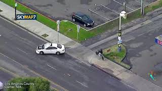 L.A Police Chase Assault Suspect  Whos Hood Is Up Over Windshield