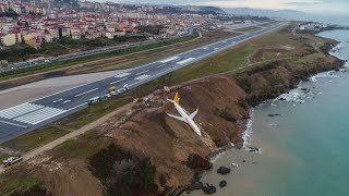 passenger plane skidded off the runway and was left stuck precariou...