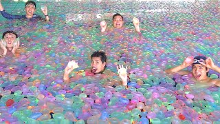 What happens when you put 55,000 water balloons in a pool!?