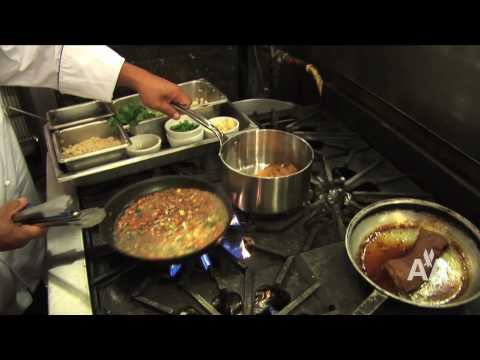Chef Sam Choy cooks Pork Belly dish from American Airlines new Chicago-Beijing Menu