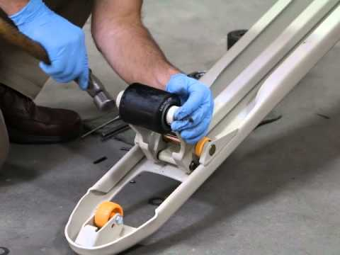 Replace the load wheels on a pallet jack