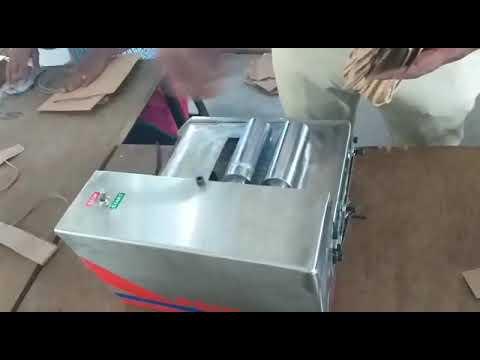 Paper bag handle pasting machine