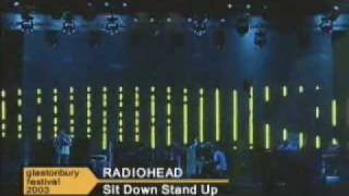 "Radiohead, at Glastonbury Festival in 2003, playing ""Sit Down. Stan..."
