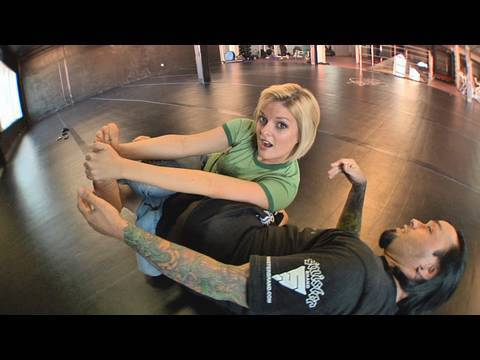 Eddie Bravo shows the Vaporizer leg lock on Joanne of MMA Girls