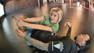 Eddie Bravo shows the Vaporizer leg lock on Joanne of MMA Girls thumbnail
