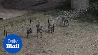 US troops put up barb wire along border in Hidalgo, Texas