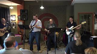 Tony, Guthrie, Nic, Chris Performing Don't Let Me Down Main Street Music and Art Studio
