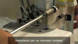Surjeteuse TOYOTA Série SL1TX: Comment changer le couteau supérieur ?