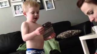 Tommy opening his Easter package. Thumbnail