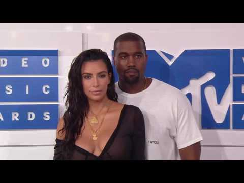 Kim Kardashian West and Kanye West walk the red carpet at the 2016 MTV VMAs.
