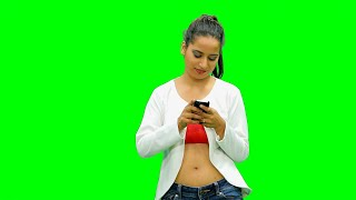 Cute girl standing and texting against the green screen
