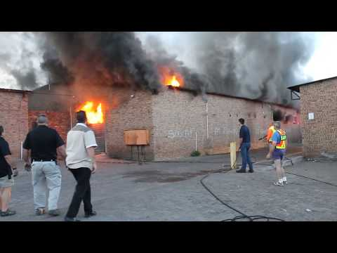Explosion with fireman trapped inside, after building caught fire