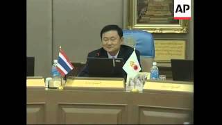 1. Reporters waiting at Government House 2. Various of Thai Prime Minister Thaksin Shinawatra arriving, photographed by
