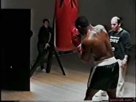 mike tyson showing his power on the heavy bag