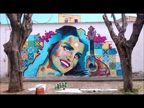 Austrian artist Carola Deutsch and her team paints a mural in Faro - Portugal
