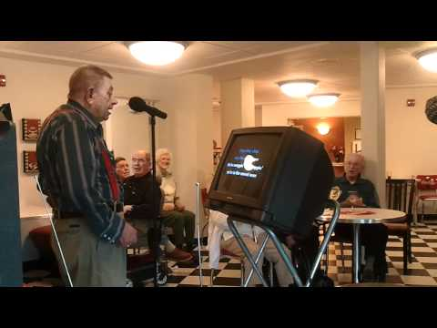Sea view senior living residents enjoy karaoke