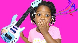Fun Little Girl Plays with Disney Frozen Toy Guitar and Starts a Band