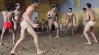 Virender Singh aka Goonga Pehalwan practicing with his students