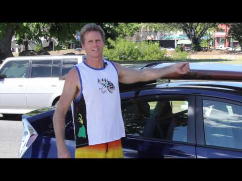 How to strap a SUP or surfboard to a car without roof racks