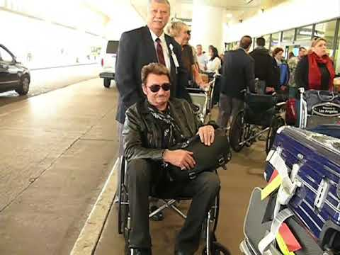 Johnny Hallyday Takes It Easy In A Wheelchair As He Arrives In L.A. For Surgery [2009]