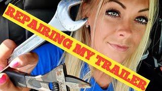 #4 Angelica Larsson repairing the trailer/wagon