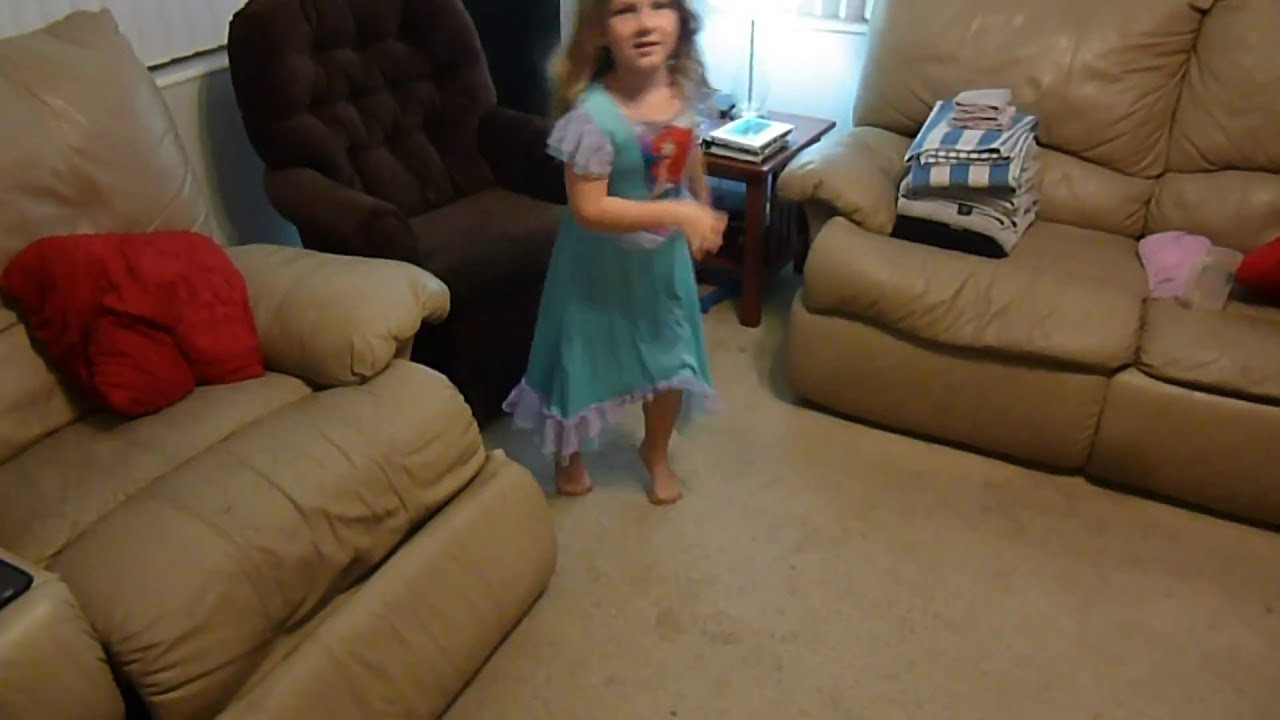 4 year old Rachel walking on her curled up toes